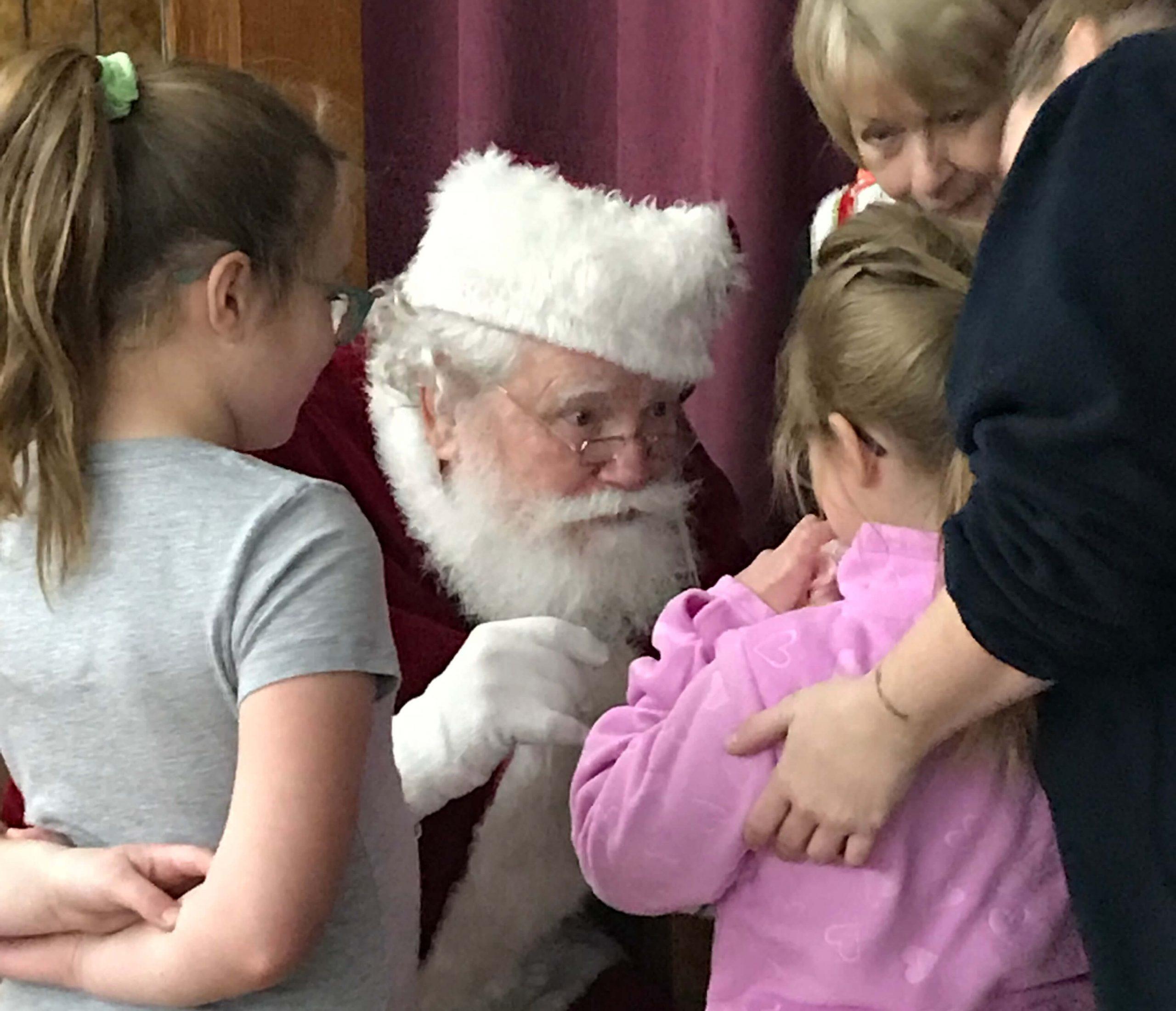 Santa at clothe a child
